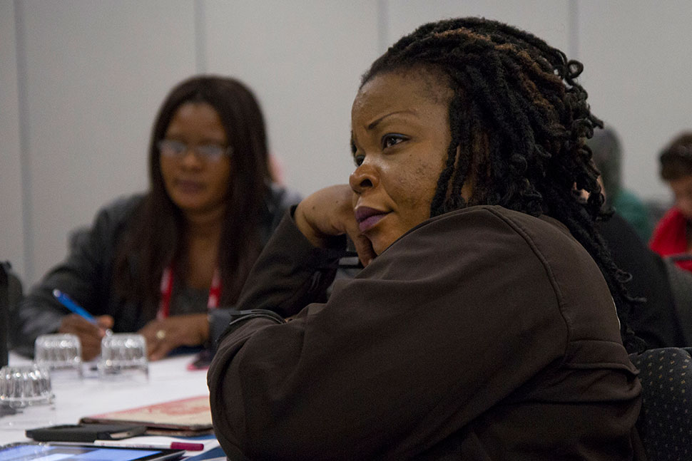Ngozi Ukachi, a fellow from the University of Lagos in Nigeria, listens to the program.