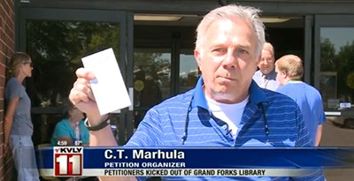 C. T. Marhula talks to press outside the Grand Forks (N. Dak.) Public Library