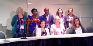Top row (left to right): Lesley Farmer, Gertrude C. Umunnakwe, Emmanuel U. Anyanwu, Valérie Glass, Isabel Mendinhos. Seated (left to right): Clayton Copeland, Karen Gavigan, and Elizabeth Burns.