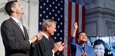 Carla D. Hayden was sworn in by Chief Justice John G. Roberts Jr., center, on Wednesday as the new librarian of Congress. Paul D. Ryan, the speaker of the House, was at left