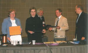From left, Barbara Bailey, Jan Nocek, Peter Chase, and George Christian receive the Robert Downs Award in 2006 from then-ALA President Michael Gorman (center). Photo: George M. Eberhart