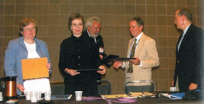 Left to right: Barbara Bailey, Jan Nocek, ALA President Michael Gorman, Peter Chase, George Christian, receiving the Robert Downs Award in 2006
