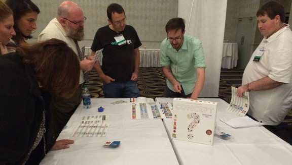 Attendees at the Gaming As Meaningful Education conference try out new tabletop games for the classroom.