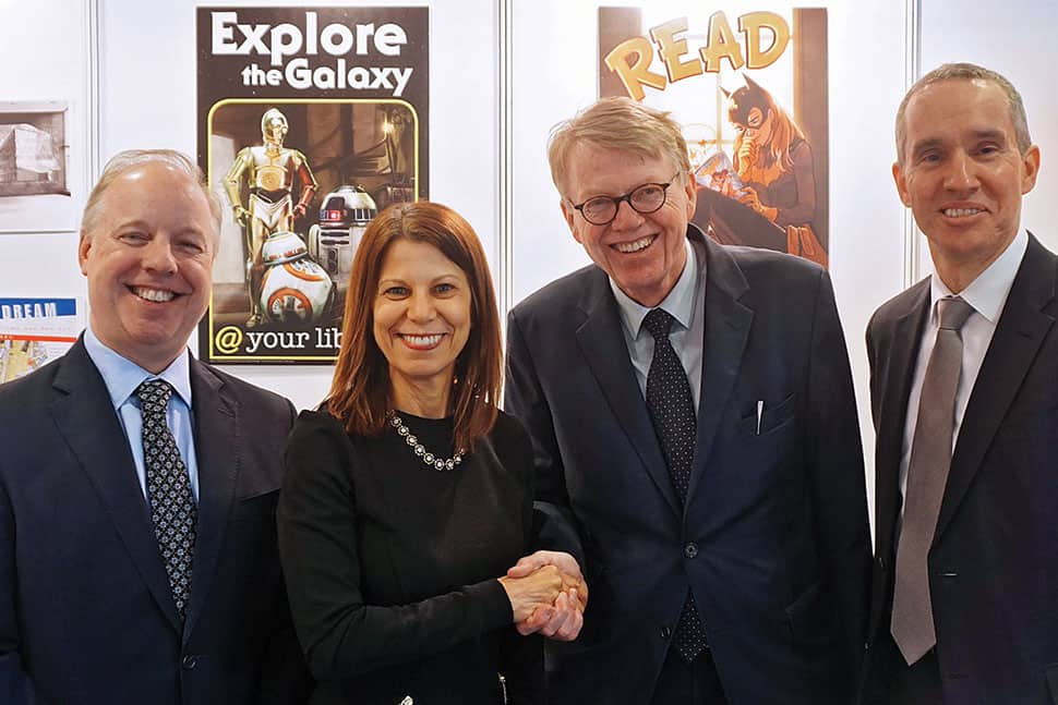 ALA and the German Library Association (BID) celebrated the start of a three-year partnership between US and German libraries at the German Library Congress in Leipzig March 14–17. From left: Kent Logsdon, deputy chief of mission, US Embassy in Germany; ALA Past President Sari Feldman; BID President Heinz-Jürgen Lorenzen; and Scott R. Riedmann, US consul general in Leipzig. Photo: Melanie Duong
