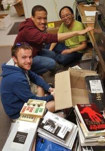 Virginia Tech graduate students sort through books donated to the Mzuni Library Initiative. Photo: Ralph Hall