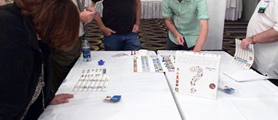 Attendees at the Gaming As Meaningful Education conference try out new tabletop games for the classroom