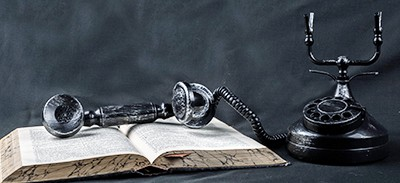 Old telephone and book