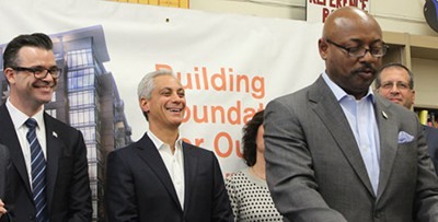 Eugene Jones, CEO of the Chicago Housing Authority, speaks about the new mixed housing-library developments, while Library Commissioner Brian Bannon and Mayor Rahm Emanuel look on. Photo by DNAinfo/Patty Wetli