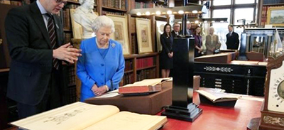 Queen Elizabeth II views the King George III archives at Windsor Castle