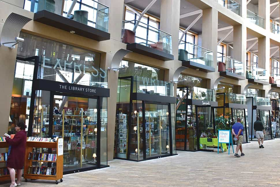The Salt Lake City Public Library's shared space includes a library store, art gallery, hair salon, florist, public radio station, and coffee shop.