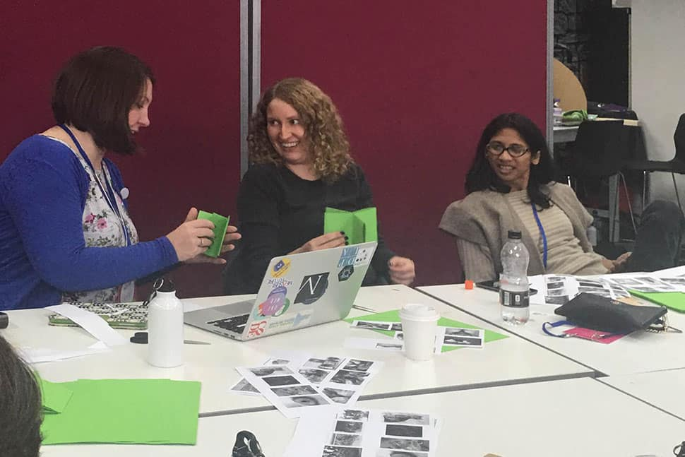 Attendees make one-page zines with open source materials at MozFest, October 28–29 in London.