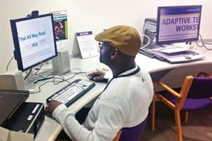 Ken Redd uses a screen magnification program on an adaptive computer workstation at the Ohio Library for the Blind and Physically Disabled.