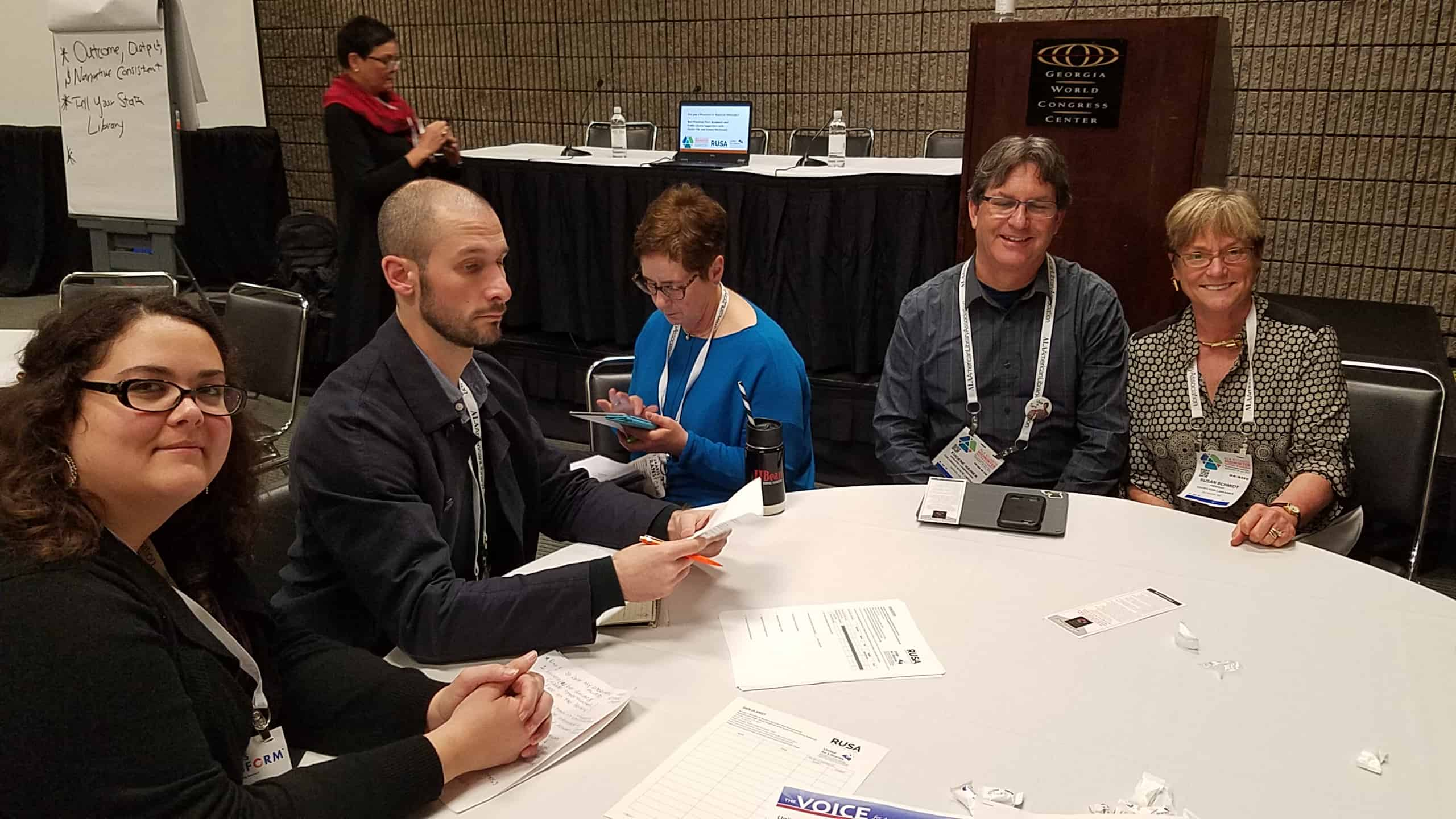 One of the breakout groups at the advocacy meeting. From left: Casey Wallace, Christopher Moffat, Elissa Checov (a 2016 I Love My Librarian winner), Eugene Hamer, and Susan J. Schmidt (United for Libraries president). In the background is Donna McDonald (United for Libraries secretary).