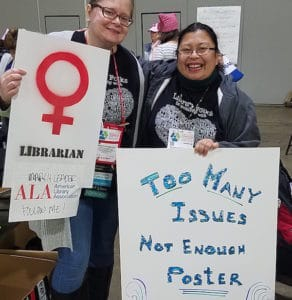 Marchers holding posters