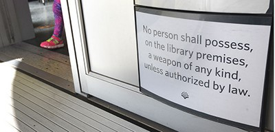 "Columbia (Mo.) Public Library changed its sign banning guns on February 17 by adding ""unless authorized by law"""