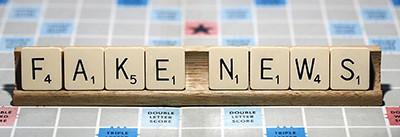 Fake news on Scrabble tiles
