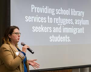 "MaryAnne Confer, librarian at Farragut Career Academy in Chicago, shares the types of services and support her school library offers for refugees, asylum seekers, and immigrants. <span class=""credit"">Photo: Rebecca Lomax/American Libraries</span>"