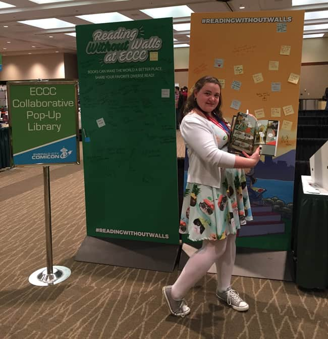 Librarian Jessica Werner of Seattle Public Library recommends Moonshot: The Indigenous Comics Collection by Hope Nicholson for inclusion in school library collections. (Photo: Amie Wright)