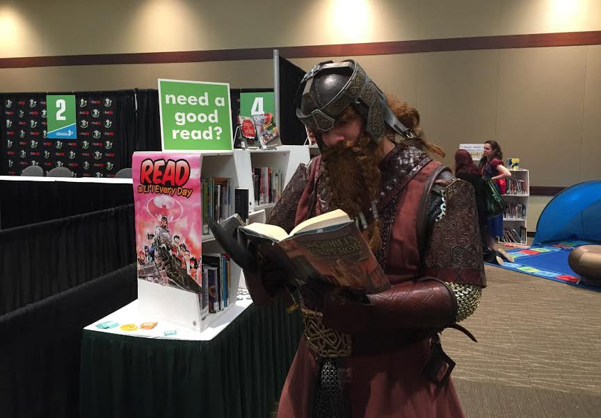Ammon Henrikson (as Gimli from Lord of the Rings) expands his reading horizons, perusing The Goblin Emperor by Katherine Addison. (Photo: Amie Wright)