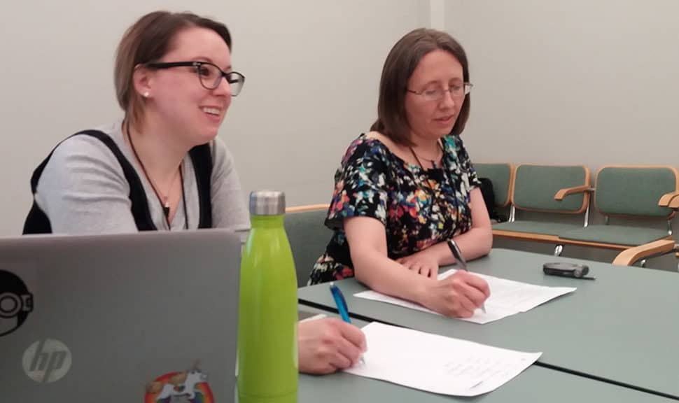 "Angelina Zaytsev (left), collection services librarian at HathiTrust, and Kristina Eden, copyright review project manager at HathiTrust, lead the session ""Harnessing Volunteer Power for Operational and Programmatic Success"" at DPLAfest 2017 in Chicago. Photo: Terra Dankowski/American Libraries"