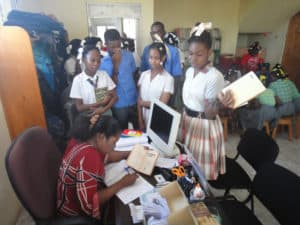 Students check out books in the Petit Goave Public Library in Haiti.