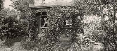 Mark Twain in the octagonal study built specially for him in 1874 at Quarry Farm, Elmira, New York