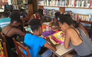 Students in the Soufrière (St. Lucia) Young Authors project work on their projects during the weeklong workshop.