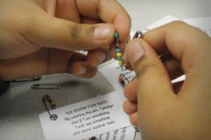 """The library circulation desk at Oliver McCracken Middle School in Skokie, Illinois, offers """"No Room for Hate"""" pins assembled by the Social Justice Club that demonstrate a wearer's pledge to stand up against injustice."""