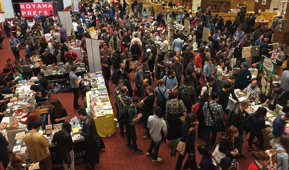 Attendees meet publishers at the Toronto Comic Arts Festival, May 13­–14, 2017.