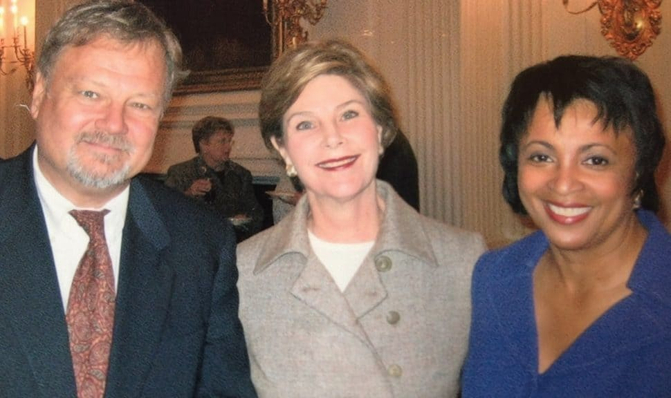 Keith Michael Fiels with then–First Lady Laura Bush and then–ALA President Carla Hayden in 2003.