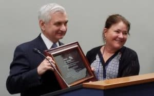Sen. Jack Reed (D-R.I.) receives the United for Libraries Public Service Award from Executive Director Sally Reed.