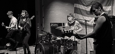 Hemlines perform in the basement of the Martin Luther King Jr. Memorial Library. Photo by Mike Maguire
