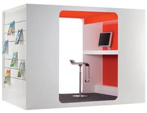 Image of the Cocoon Media Lounge, a box with slatwall attachments and a chair inside.