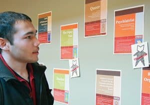 "Williams College used a ""wall catalog"" to highlight its ""books."" Each book was represented by a poster that included a title, keywords, and suggested conversation starters. <span class=""credit"">Photo: Williams College Communications Office</span>"