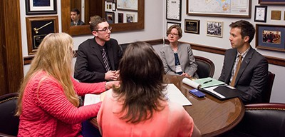 The Virginia delegation speaks with a staffer at Rep. Bobby Scott's office. Photo by Andrew Propp