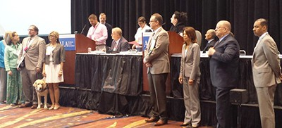 ALA Executive Board members read a tribute to retiring Executive Director Keith Michael Fiels (seated)