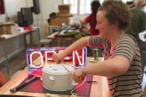 Patron Rebecca Bloom repairs a rice cooker at Boulder (Colo.) Public Library's U-Fix-It Clinic.