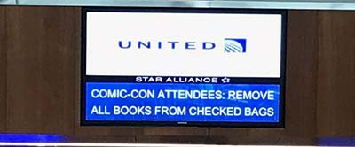 United sign warns passengers not to check comics in luggage