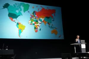 IFLA Secretary General Gerald Leitner shows a world map indicating the 140 countries that have so far participated in Global Vision Discussions.