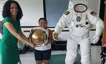 NASA employees brought a real astronaut suit to the Garfield Park Lending Library in New Castle, Delaware, for NASA Day @ Your Library in July. (Photo: Yumarys Polanco-Miller)