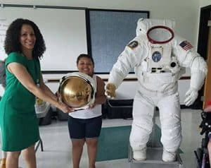 "ILC Dover, a company that manufactures equipment for NASA, brought a real astronaut suit to the Garfield Park Lending Library in New Castle, Delaware, for NASA Day @ Your Library in July. <span class=""credit"">Photo: Yumarys Polanco-Miller</span>"