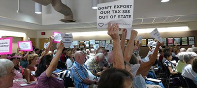 Nearly 200 people opposed to the outsourcing of Escondido's library services made their feelings known Tuesday afternoon during a meeting of the library trustees. Photo by J. Harry Jones