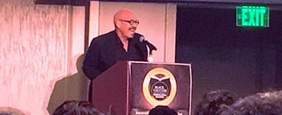 Radio host Tom Joyner addresses the crowd at the 10th National Conference of African American Librarians in Atlanta on August 10