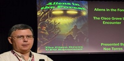 McAllen (Tex.) High School librarian Noe Torres talking about one of his books on UFOs