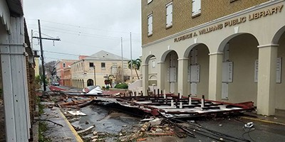 Debris blocks King Street in Christiansted, US Virgin Islands, in front of the Florence Williams Library on September 20