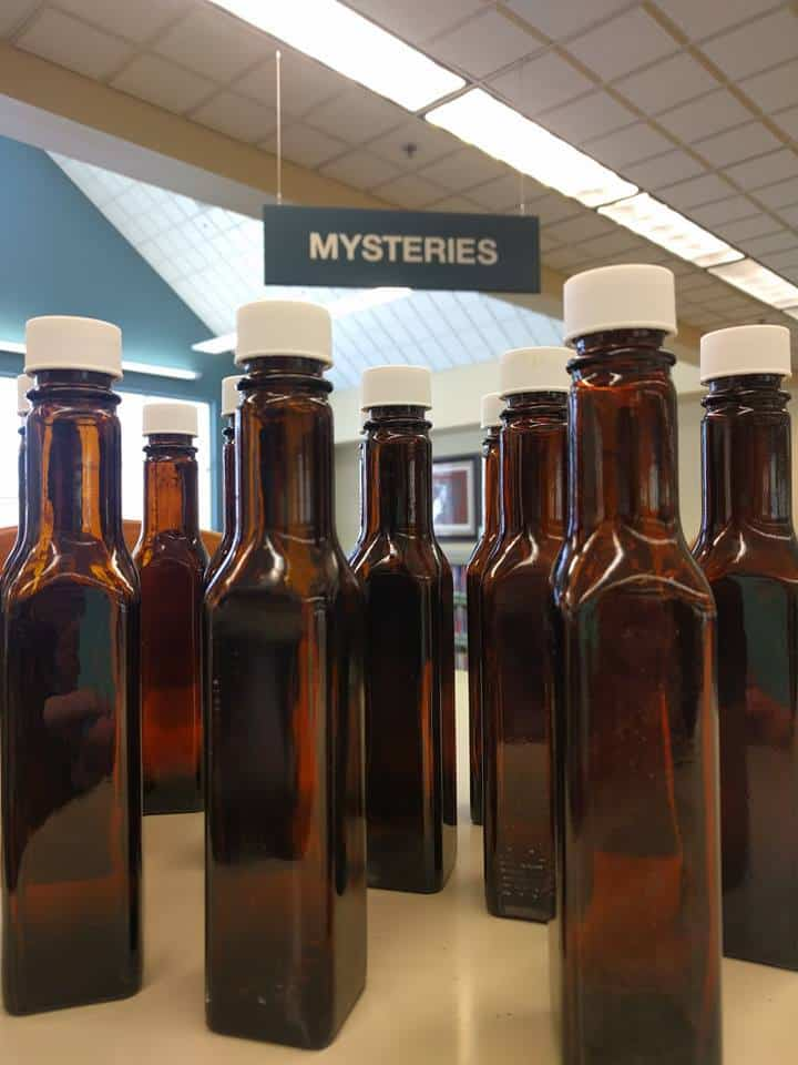 "The copycat bottle that Vicki George found on March 23 was located in the Mysteries section. Dan Cotton agreed that the bottle's location made the copycat find a little ""obvious."" Photo: Courtesy of Avon Lake Public Library"
