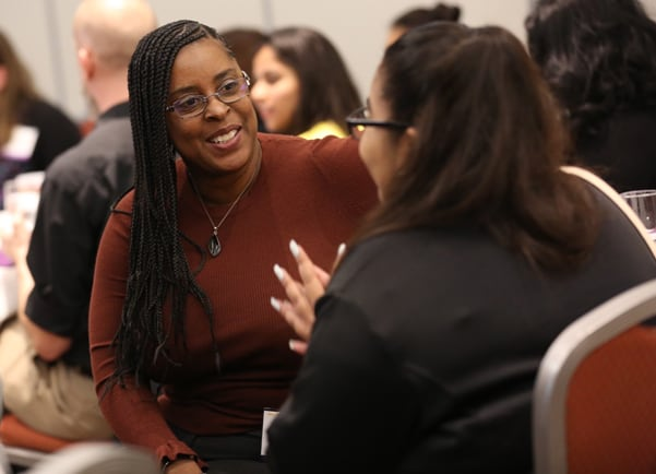 Mentor Jené Brown, associate director of engagement and outreach at Los Angeles Public Library, engages with an Inclusive Internship Initiative participant at the commencement event on October 14. (Photo: Tori Soper)