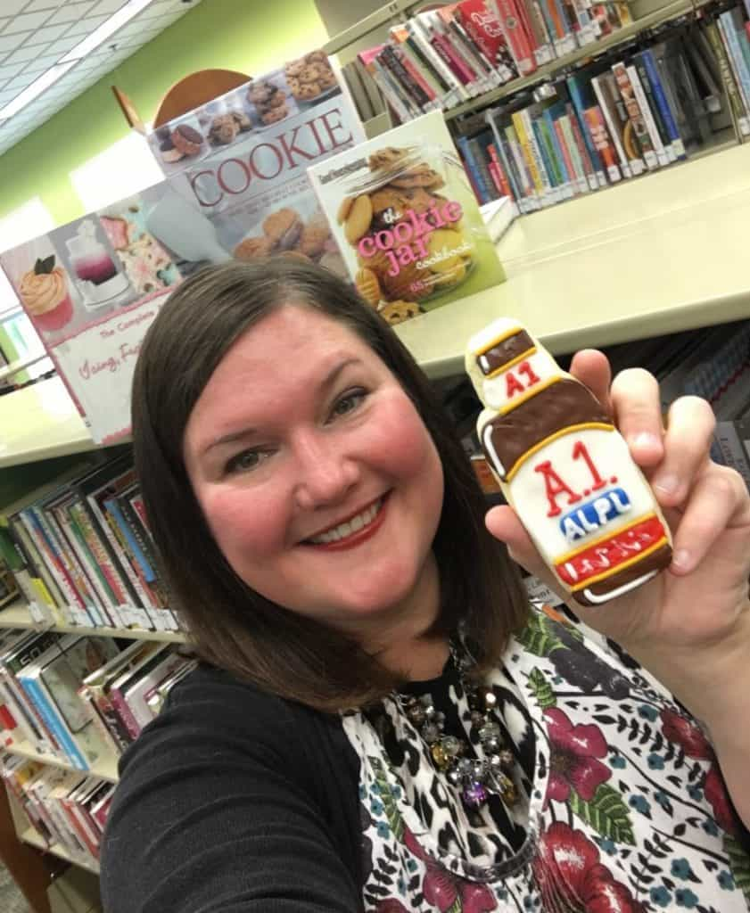 Shea Alltmont started as public relations and marketing coordinator in August, but she was already acquainted with the mystery thanks to local media. In June, she baked cookies for library staffers and her friend Jill Ralston in the shape of A1 Sauce bottles. Photo: Courtesy of Avon Lake Public Library