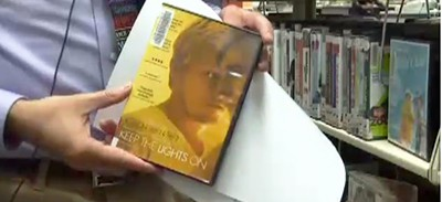 Baker County (Oreg.) Public Library Director Perry Stokes holds one of the misplaced DVDs. Screenshot from newscast