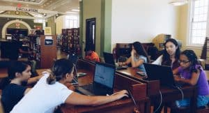 2016 Congressional App Challenge winner Kayla Leung (second from right) teaches coding at Perth Amboy (N.J.) Public Library.